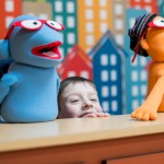 Child playing with two puppets.